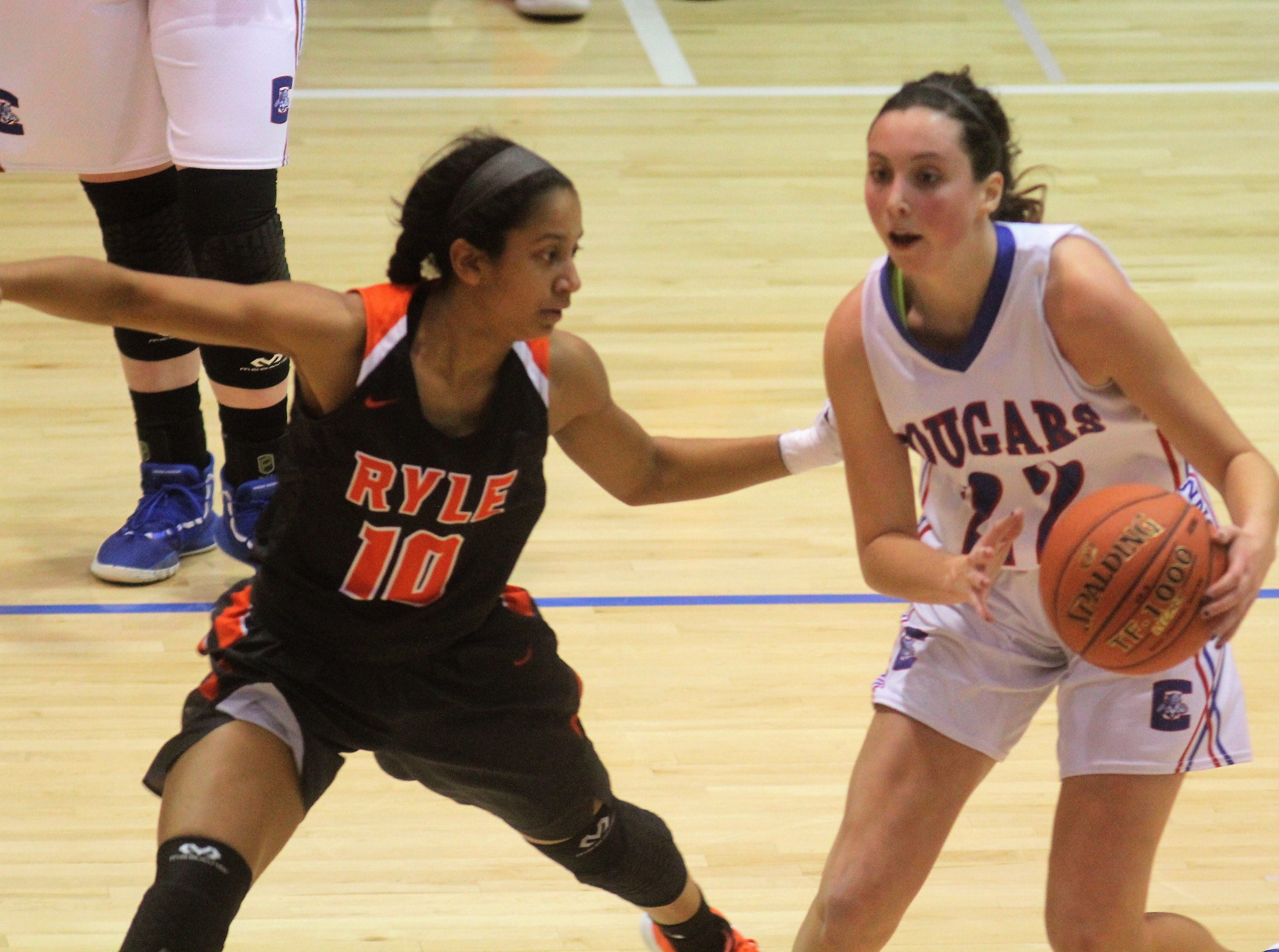 Ryle senior Juliet McGregor keeps an eye on Conner senior Maddie Burcham as Ryle defeated Conner 60-49 in a girls basketball district game Dec. 7, 2018 at Conner High School, Hebron KY.