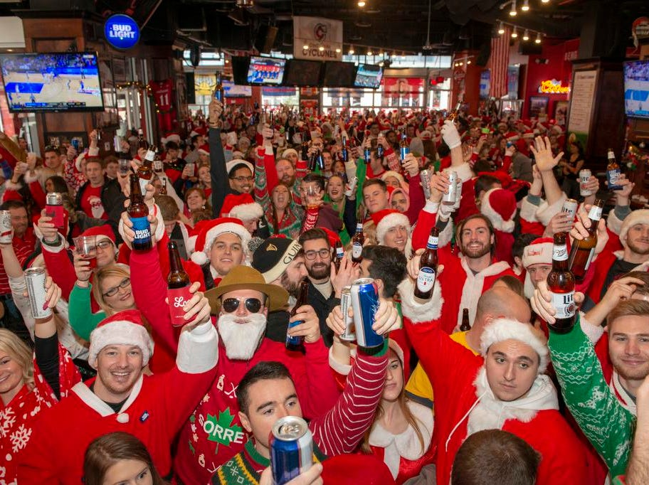 Cincinnati SantaCon 2018 brought hundreds of people dressed as Santa Claus and other Christmas characters to The Banks to spread good cheer and charity. The Holy Grail at full Santa capacity.