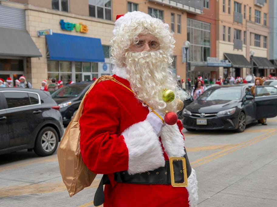 Cincinnati SantaCon 2018 brought hundreds of people dressed as Santa Claus and other Christmas characters to The Banks to spread good cheer and charity.