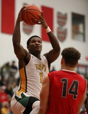 Taft forward Chris'seon Stringer drives to the basket during the Senators' game against Deer Park, Friday, Dec. 7 , 2018.