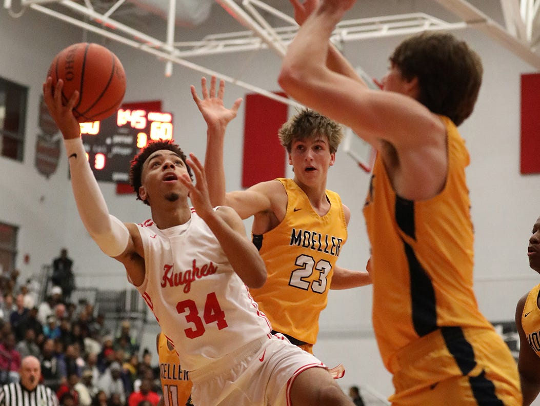 Hughes guard Paul McMillan drives to the basket during their basketball game against Moeller, Friday, Dec. 7, 2018.