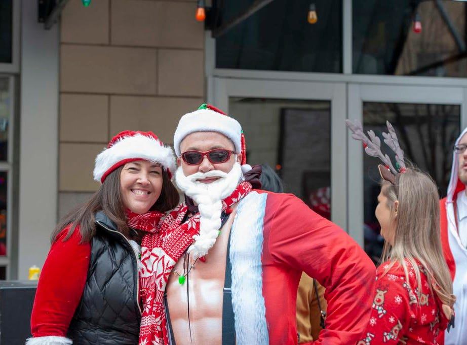 Cincinnati SantaCon 2018 brought hundreds of people dressed as Santa Claus and other Christmas characters to The Banks to spread good cheer and charity. Jill Brown and David Wyman.
