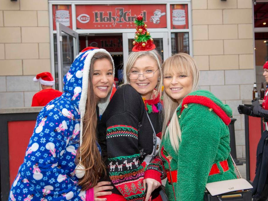 Cincinnati SantaCon 2018 brought hundreds of people dressed as Santa Claus and other Christmas characters to The Banks to spread good cheer and charity. Ashley Huff, Anna Hyll and Jessica Huentelnman.
