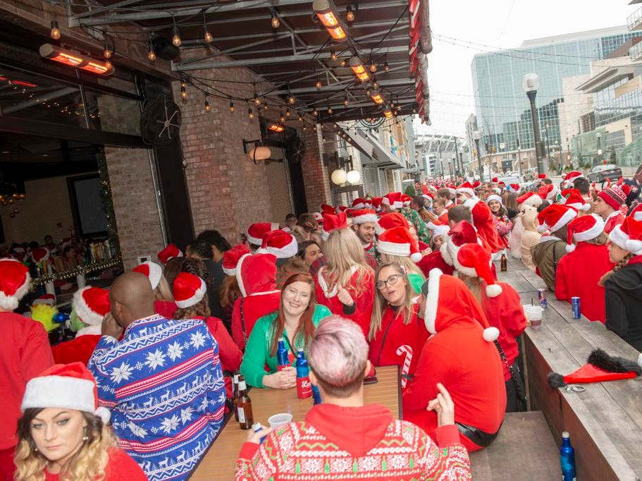 Cincinnati SantaCon 2018 brought hundreds of people dressed as Santa Claus and other Christmas characters to The Banks to spread good cheer and charity. Another view of Freedom Way.