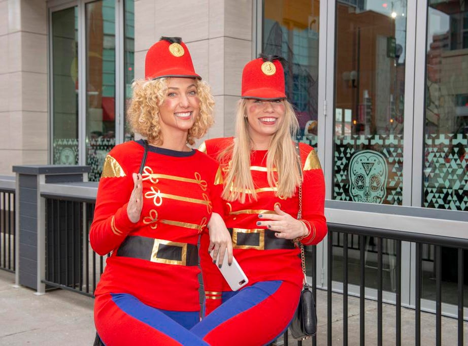 Cincinnati SantaCon 2018 brought hundreds of people dressed as Santa Claus and other Christmas characters to The Banks to spread good cheer and charity. Lauren Bennett and Mary Fretz.