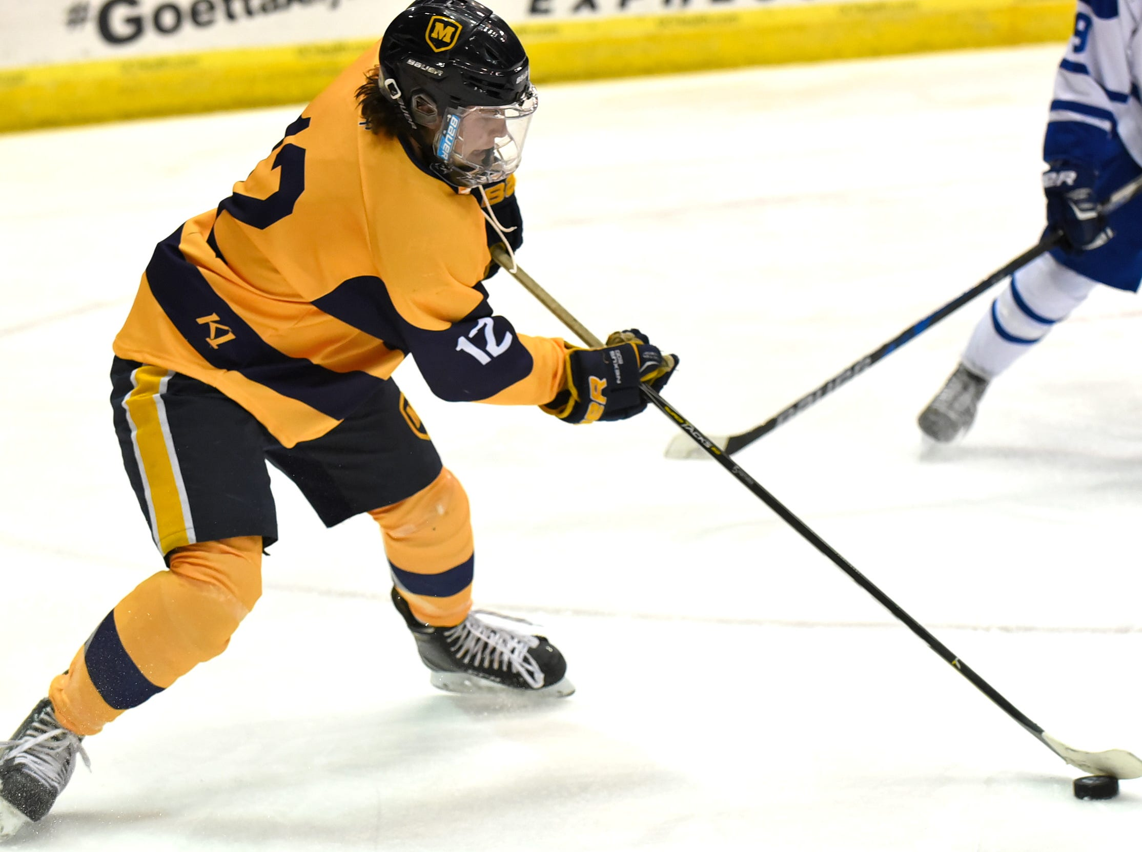Drew Totin holds control of the puck for Moeller at US Bank Arena, December 7, 2018.