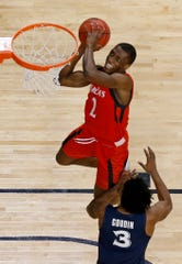 Cincinnati Bearcats guard Keith Williams (2) goes up for a dunk in the second half of the 86th Annual Crosstown Shootout basketball game between the Cincinnati Bearcats and the Xavier Musketeers at UC's Fifth Third Arena in Cincinnati on Saturday, Dec. 8, 2018. The Bearcats won the city rivalry game 62-47.