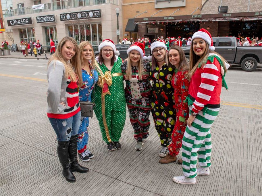 Cincinnati SantaCon 2018 brought hundreds of people dressed as Santa Claus and other Christmas characters to The Banks to spread good cheer and charity. Kasey, Madison, Brittany, Karyn, Shaina, Emily and Skyler.