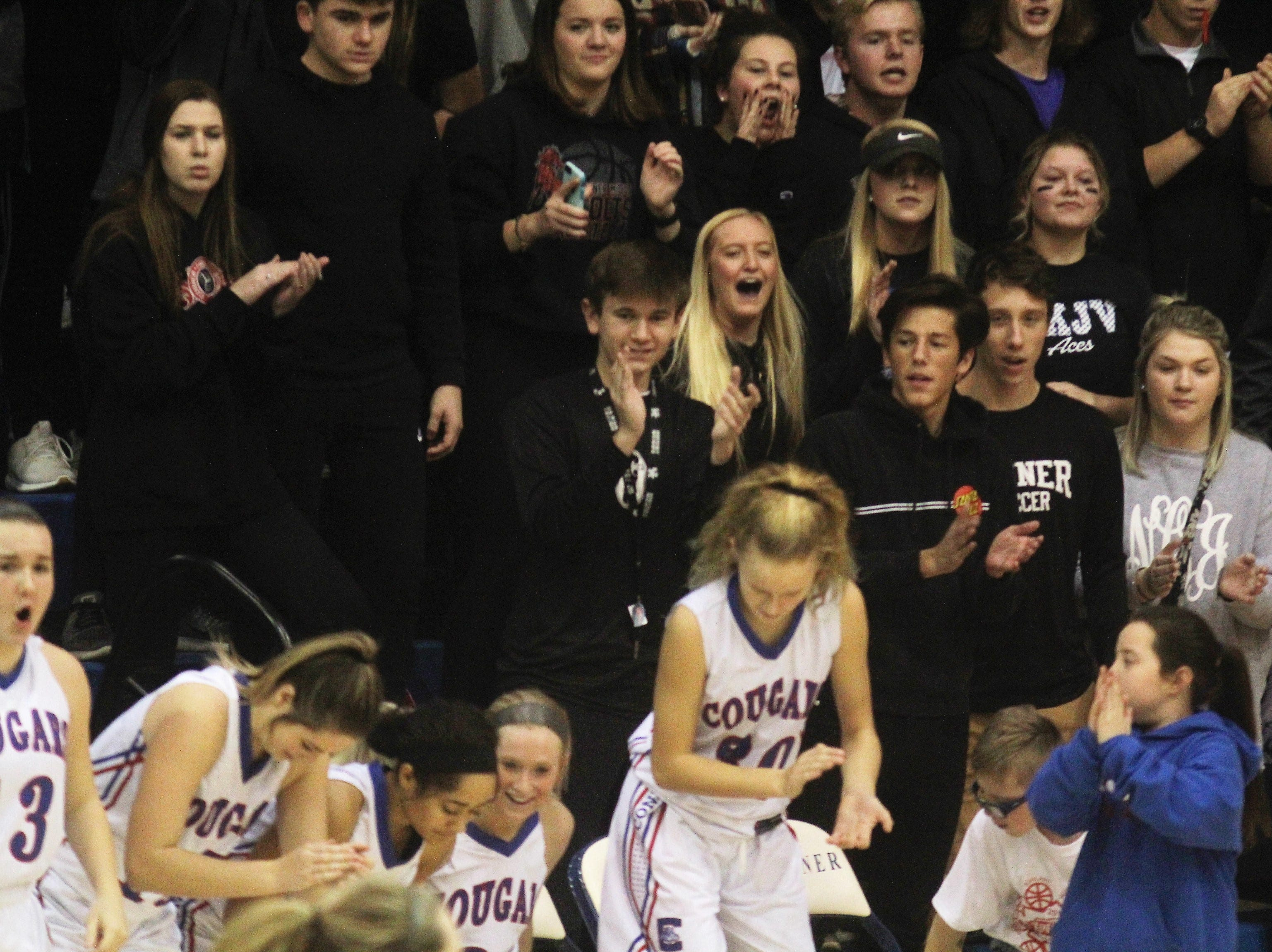 Conner students get into the action as Ryle defeated Conner 60-49 in a girls basketball district game Dec. 7, 2018 at Conner High School, Hebron KY.