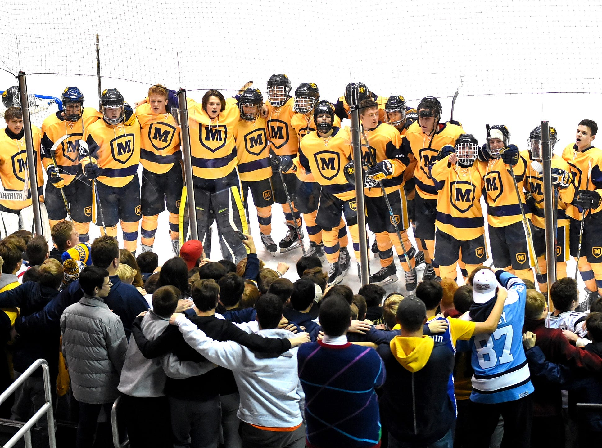 The Moeller student body and Ice Hockey Crusaders sing with joy after their 3-2 win over St. Xavier at US Bank Arena, December 7, 2018.
