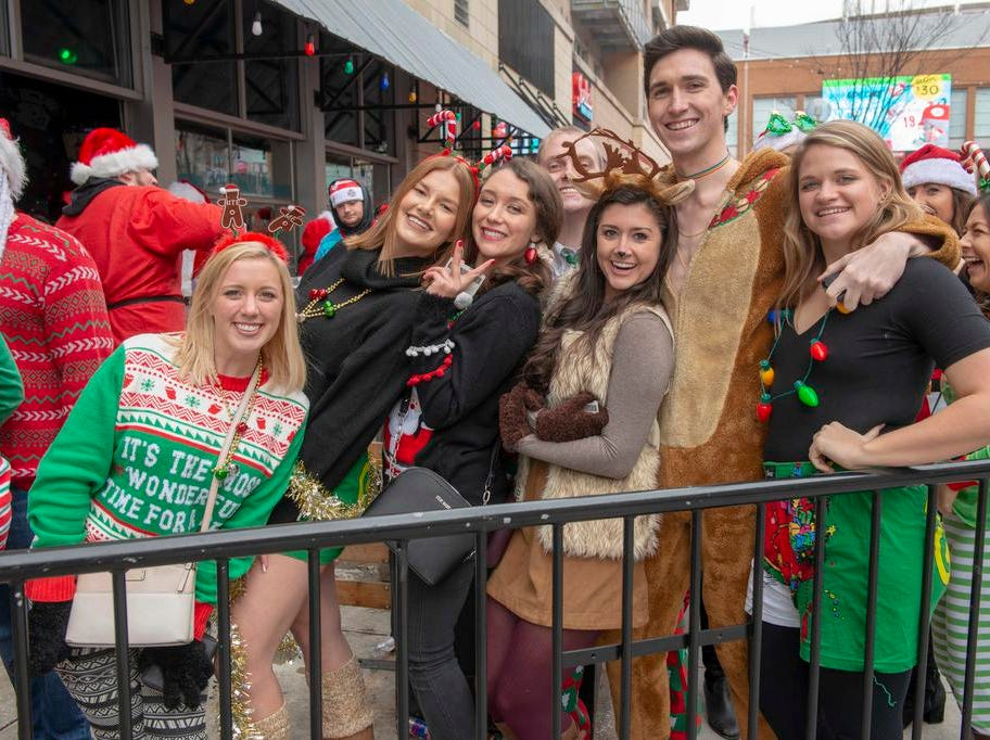 Cincinnati SantaCon 2018 brought hundreds of people dressed as Santa Claus and other Christmas characters to The Banks to spread good cheer and charity. Ashley, Megan, Katy, Ally, Parker, Molly and Neal.