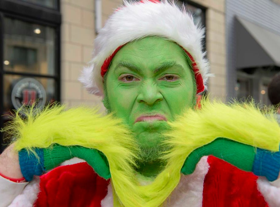 Cincinnati SantaCon 2018 brought hundreds of people dressed as Santa Claus and other Christmas characters to The Banks to spread good cheer and charity. The Grinch a.k.a. Brian Hankins.