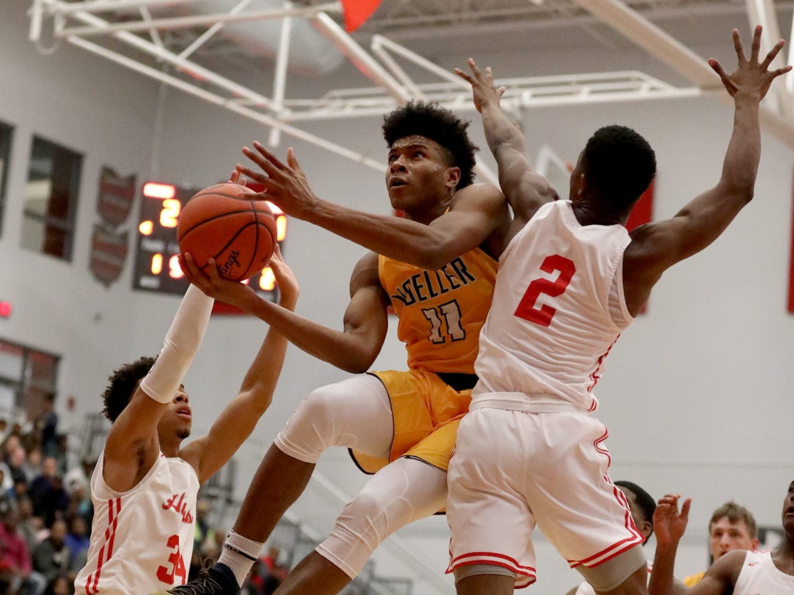 Moeller guard Miles McBride drives to the Crusaders' basketball game against Hughes, Friday, Dec. 7, 2018.