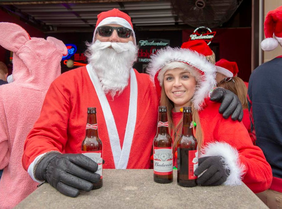 Cincinnati SantaCon 2018 brought hundreds of people dressed as Santa Claus and other Christmas characters to The Banks to spread good cheer and charity. Doug and Jessica Doughman.