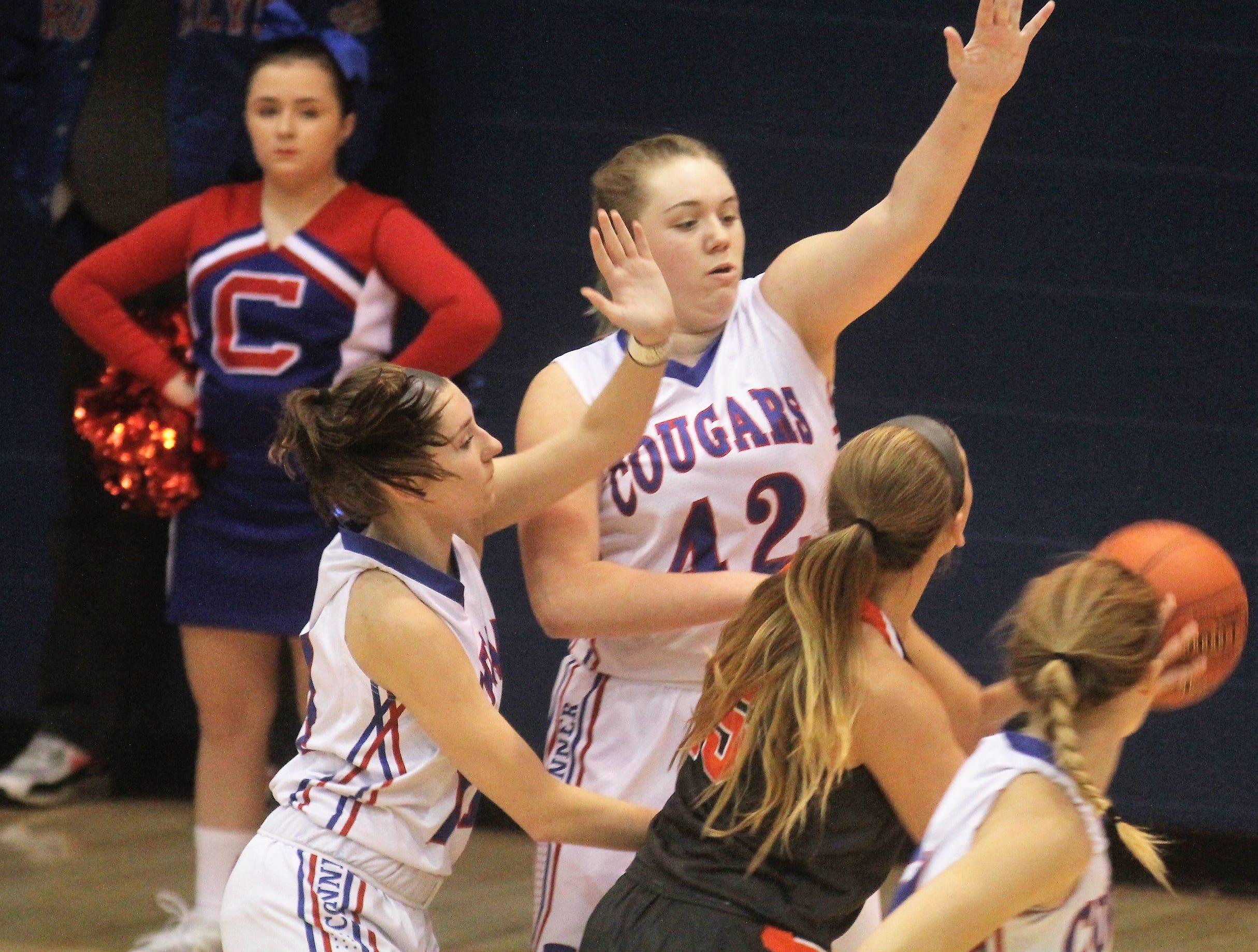 Conner junior Maddie Drummonds defends Ryle senior Lauren Schwartz as Ryle defeated Conner 60-49 in a girls basketball district game Dec. 7, 2018 at Conner High School, Hebron KY.