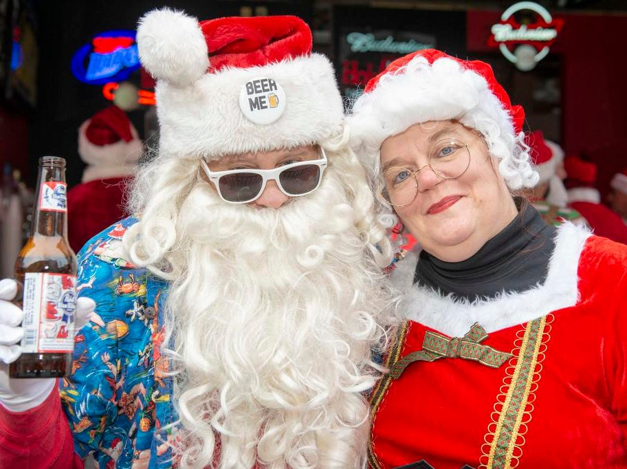 Cincinnati SantaCon 2018 brought hundreds of people dressed as Santa Claus and other Christmas characters to The Banks to spread good cheer and charity. Philip and Theresa Carver dreesd up as Mr. and Mrs. Claus.