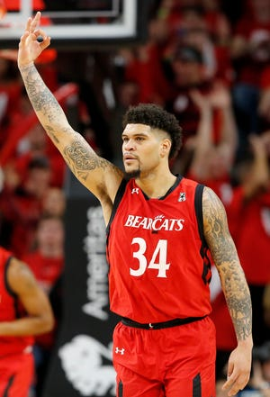 Cincinnati Bearcats guard Jarron Cumberland (34) celebrates after scoring from three point range in the first half of the 86th Annual Crosstown Shootout basketball game between the Cincinnati Bearcats and the Xavier Musketeers at UC's Fifth Third Arena in Cincinnati on Saturday, Dec. 8, 2018. The Bearcats led 28-22.