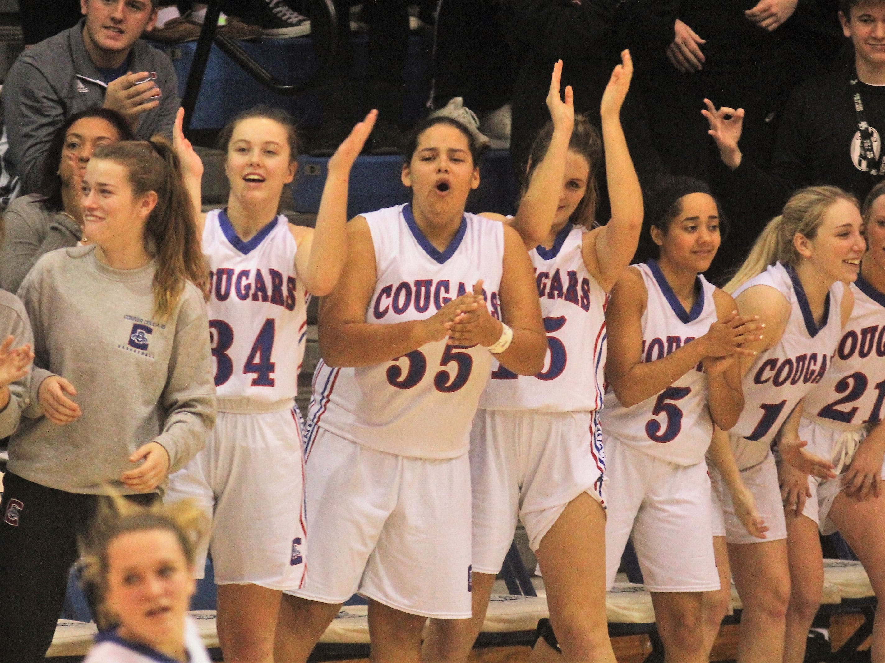 Conner players cheer a basket by their teammates as Ryle defeated Conner 60-49 in a girls basketball district game Dec. 7, 2018 at Conner High School, Hebron KY.