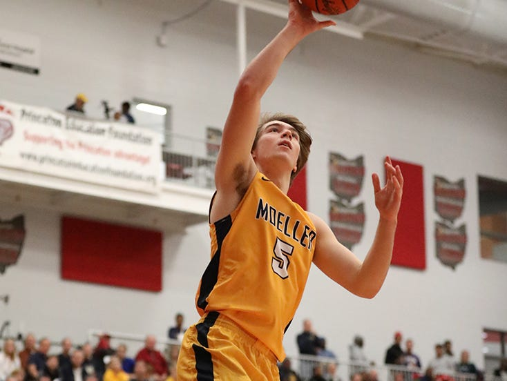 Moeller forward Alex Pfriem drives to the basket in the Crusaders' game against Hughes, Friday, Dec, 7, 2018.