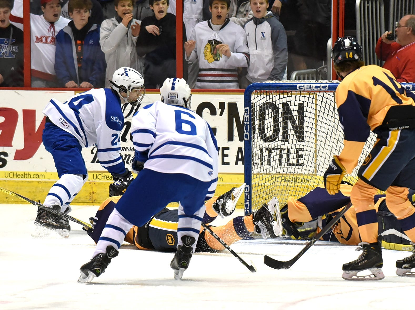 Jake Anding (24) sneaks the puck in the back corner of the goal for a St. Xavier goal at US Bank Arena, December 7, 2018.