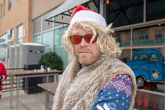 Cincinnati SantaCon 2018 brought hundreds of people dressed as Santa Claus and other Christmas characters to The Banks to spread good cheer and charity. Chris Watkins