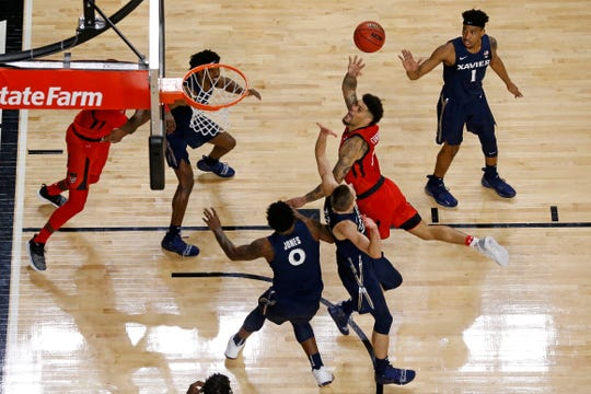 Cincinnati Bearcats guard Jarron Cumberland (34) throw up a shot in the second half of the 86th Annual Crosstown Shootout basketball game between the Cincinnati Bearcats and the Xavier Musketeers at UC's Fifth Third Arena in Cincinnati on Saturday, Dec. 8, 2018. The Bearcats won the city rivalry game 62-47.