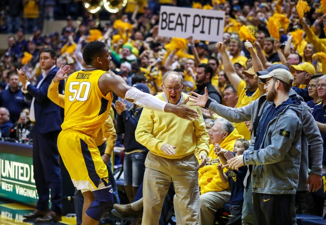 West Virginia Mountaineers forward Sagaba Konate (50) celebrates with fans after beating the Pittsburgh Panthers at WVU Coliseum on Dec. 8.