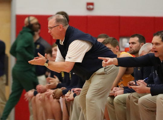 Moeller head coach Carl Kremer instructs during their basketball game against Hughes, Friday, Dec. 7, 2018.