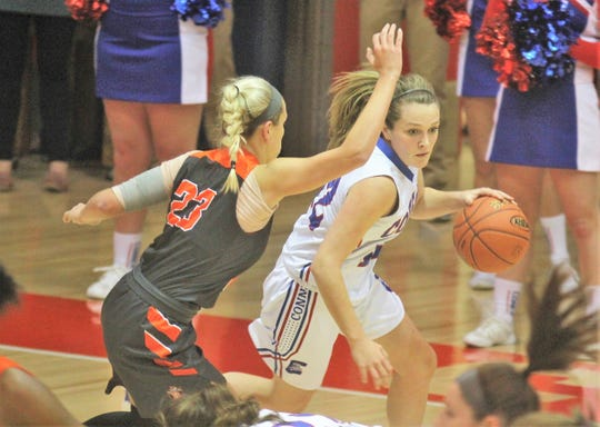 Conner senior Courtney Hurst tries to drive around Ryle junior Maddie Scherr as Ryle defeated Conner 60-49 in a girls basketball district game Dec. 7, 2018 at Conner High School, Hebron KY.