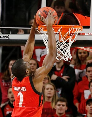 Cincinnati Bearcats guard Keith Williams (2) throws down a dunk in the first half of the 86th Annual Crosstown Shootout basketball game between the Cincinnati Bearcats and the Xavier Musketeers at UC's Fifth Third Arena in Cincinnati on Saturday, Dec. 8, 2018. The Bearcats led 28-22.