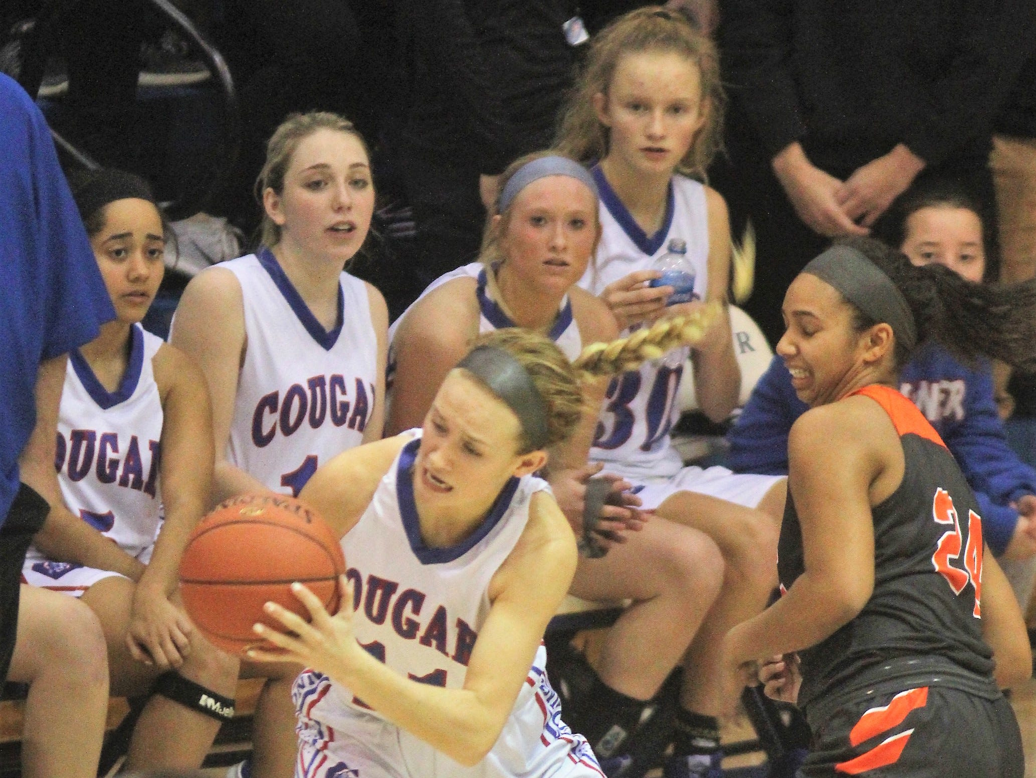 Conner senior Joy Strange gets the ball as Ryle defeated Conner 60-49 in a girls basketball district game Dec. 7, 2018 at Conner High School, Hebron KY.