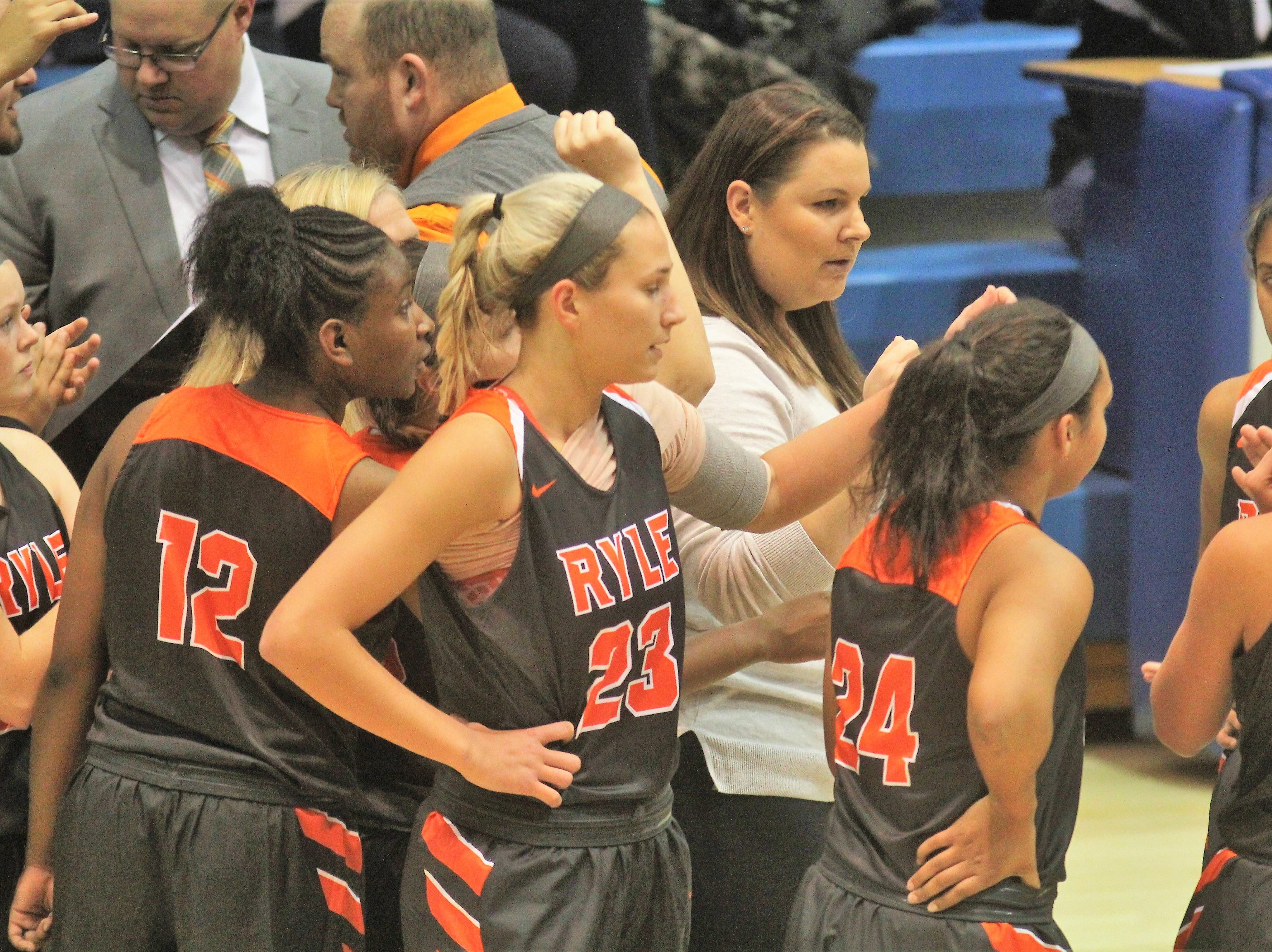 Ryle head coach Katie Haitz talks to her team as Ryle defeated Conner 60-49 in a girls basketball district game Dec. 7, 2018 at Conner High School, Hebron KY.