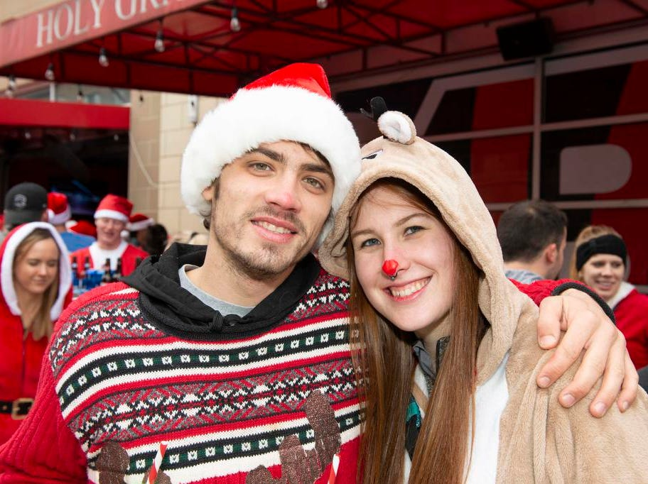 Cincinnati SantaCon 2018 brought hundreds of people dressed as Santa Claus and other Christmas characters to The Banks to spread good cheer and charity. William Pendland and Kelsey Bodine.