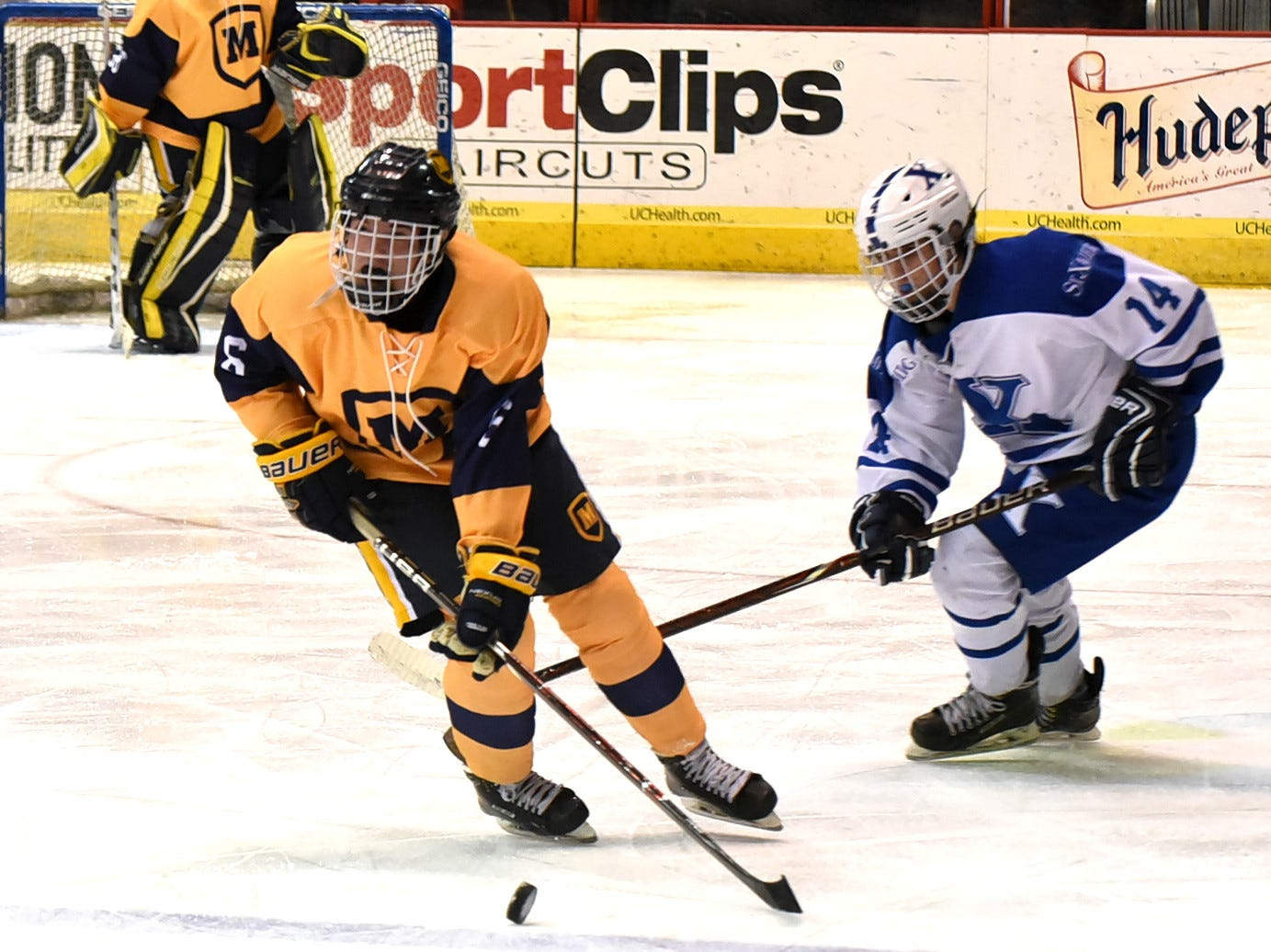 Moeller's Jacob Carota (6) takes the puck past the blue line for the Crusaders in their 3-2 win over St. Xavier at US Bank Arena, December 7, 2018.