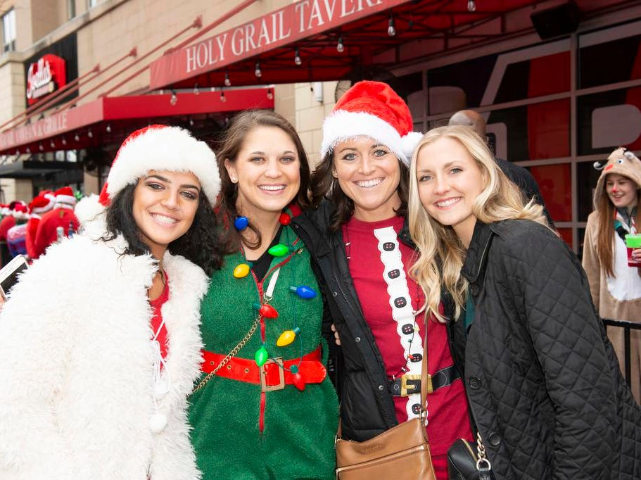Cincinnati SantaCon 2018 brought hundreds of people dressed as Santa Claus and other Christmas characters to The Banks to spread good cheer and charity. Paige Deglow, Claire Deglow, Lindsay Hartmann and Keley Klein.