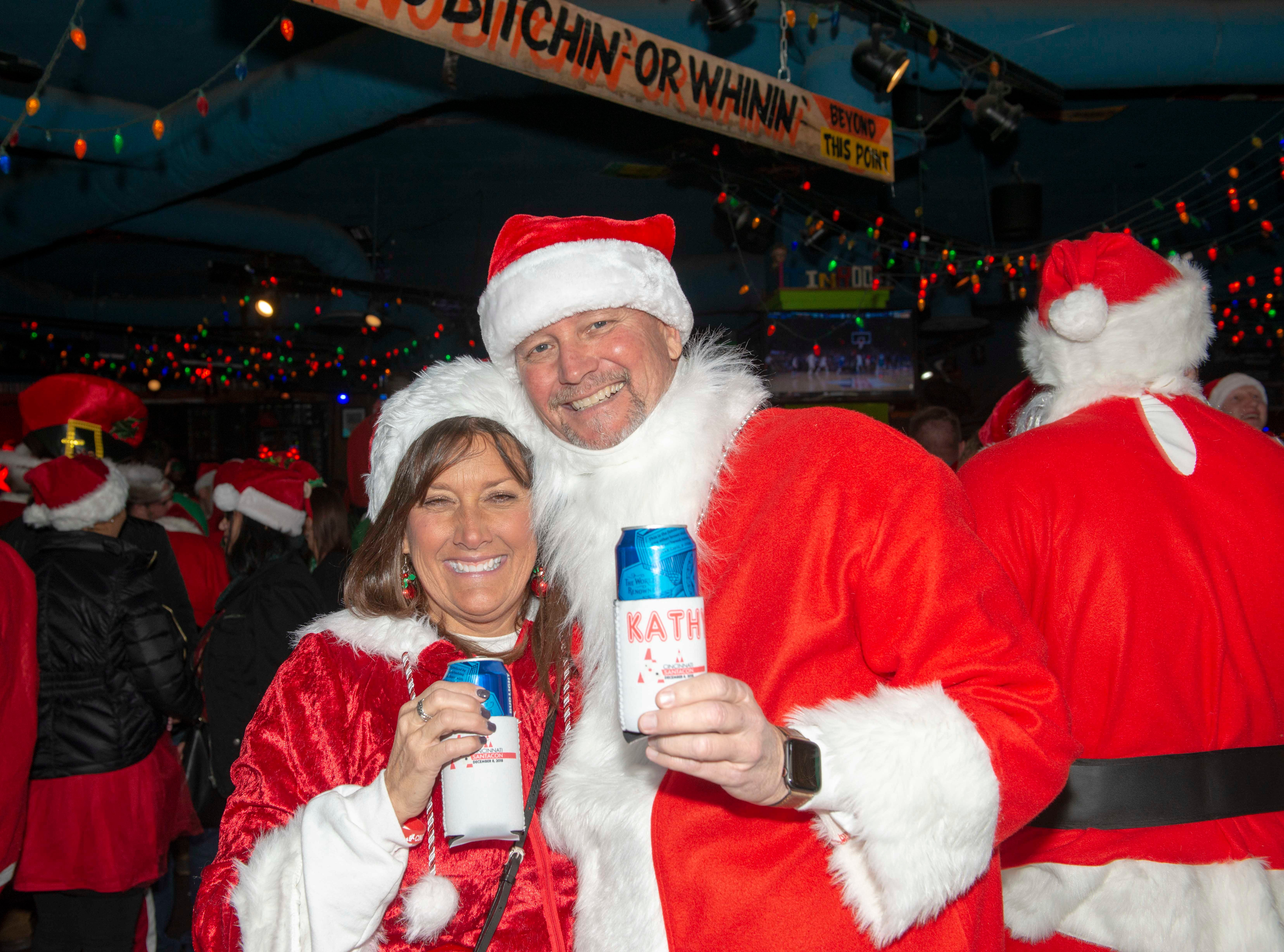 Cincinnati SantaCon 2018 brought hundreds of people dressed as Santa Claus and other Christmas characters to The Banks to spread good cheer and charity. Kathy Mills and Rob Patterson.