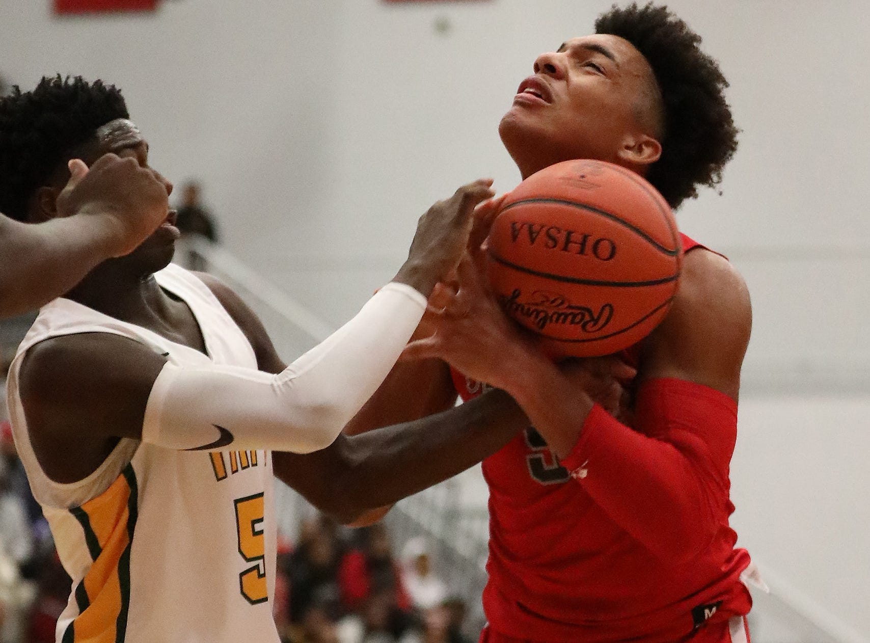Deer Park guard Mark Wise, left, battles  Taft guard Muhammad Metz for a rebound during their basketball game  Friday, Dec. 7, 2018.