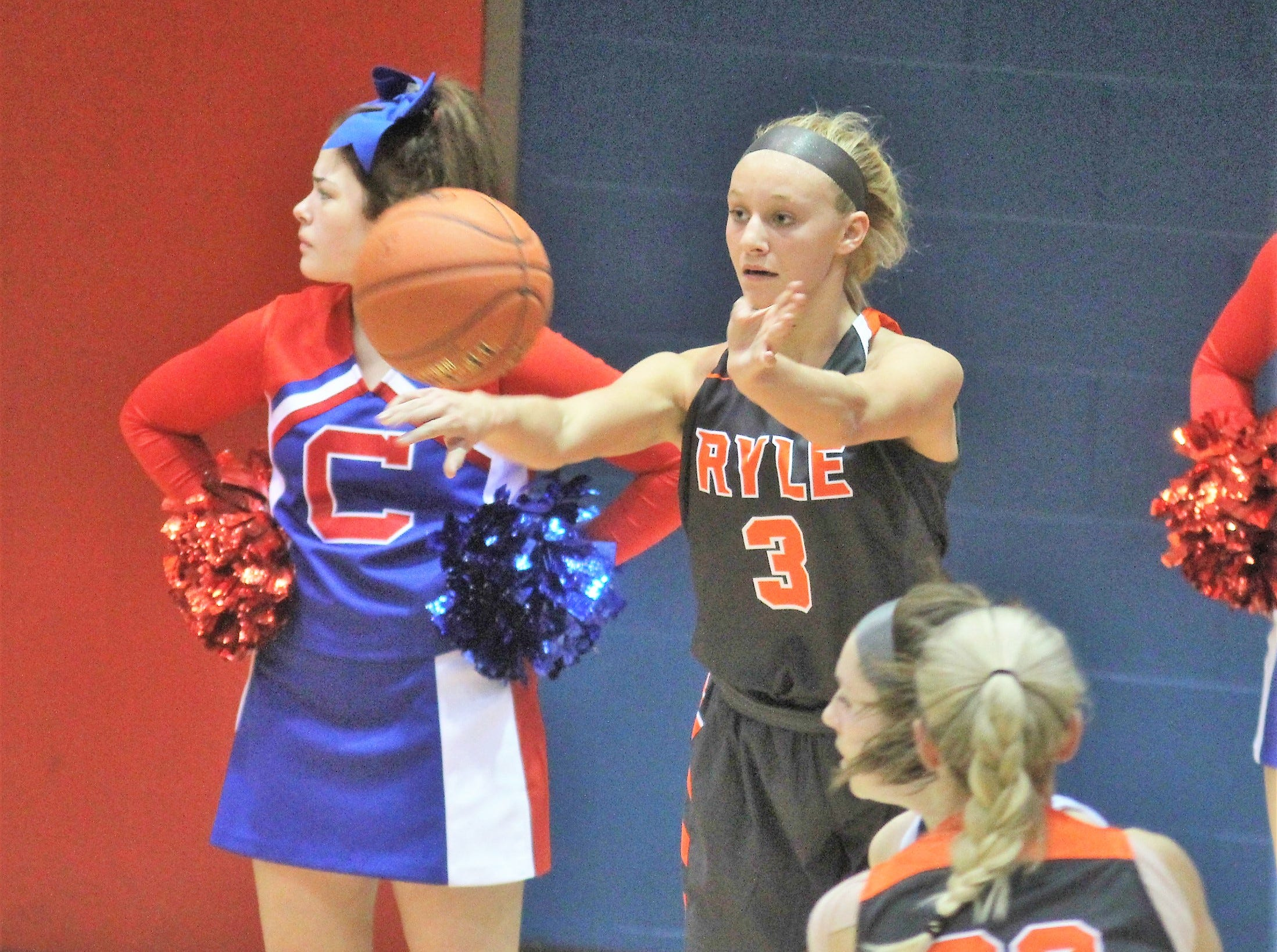Ryle sophomore Brie Crittendon inbounds the ball as Ryle defeated Conner 60-49 in a girls basketball district game Dec. 7, 2018 at Conner High School, Hebron KY.