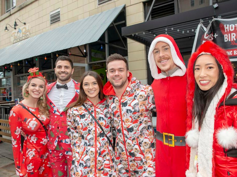 Cincinnati SantaCon 2018 brought hundreds of people dressed as Santa Claus and other Christmas characters to The Banks to spread good cheer and charity. Haylee, Matt, Sarah, Matt, Austin and Christina.