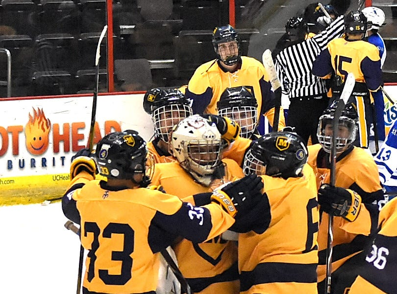 The Crusaders are jubilant as Moeller tops St. Xavier 3-2 in ice hockey at US Bank Arena, December 7, 2018.