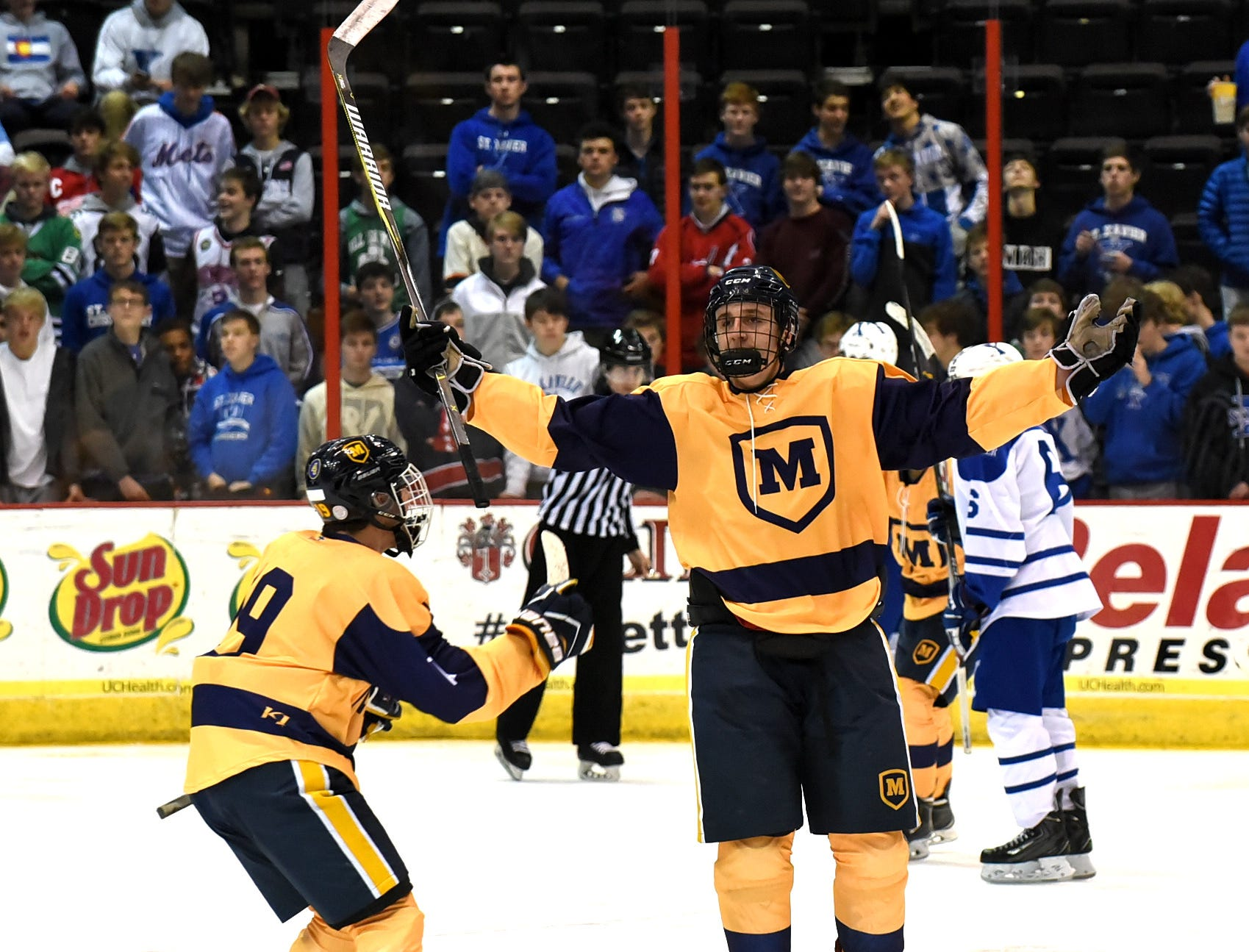 Shay Black raises his stick in celebration of what would turn out to be the winning goal for Moeller at US Bank Arena, December 7, 2018.