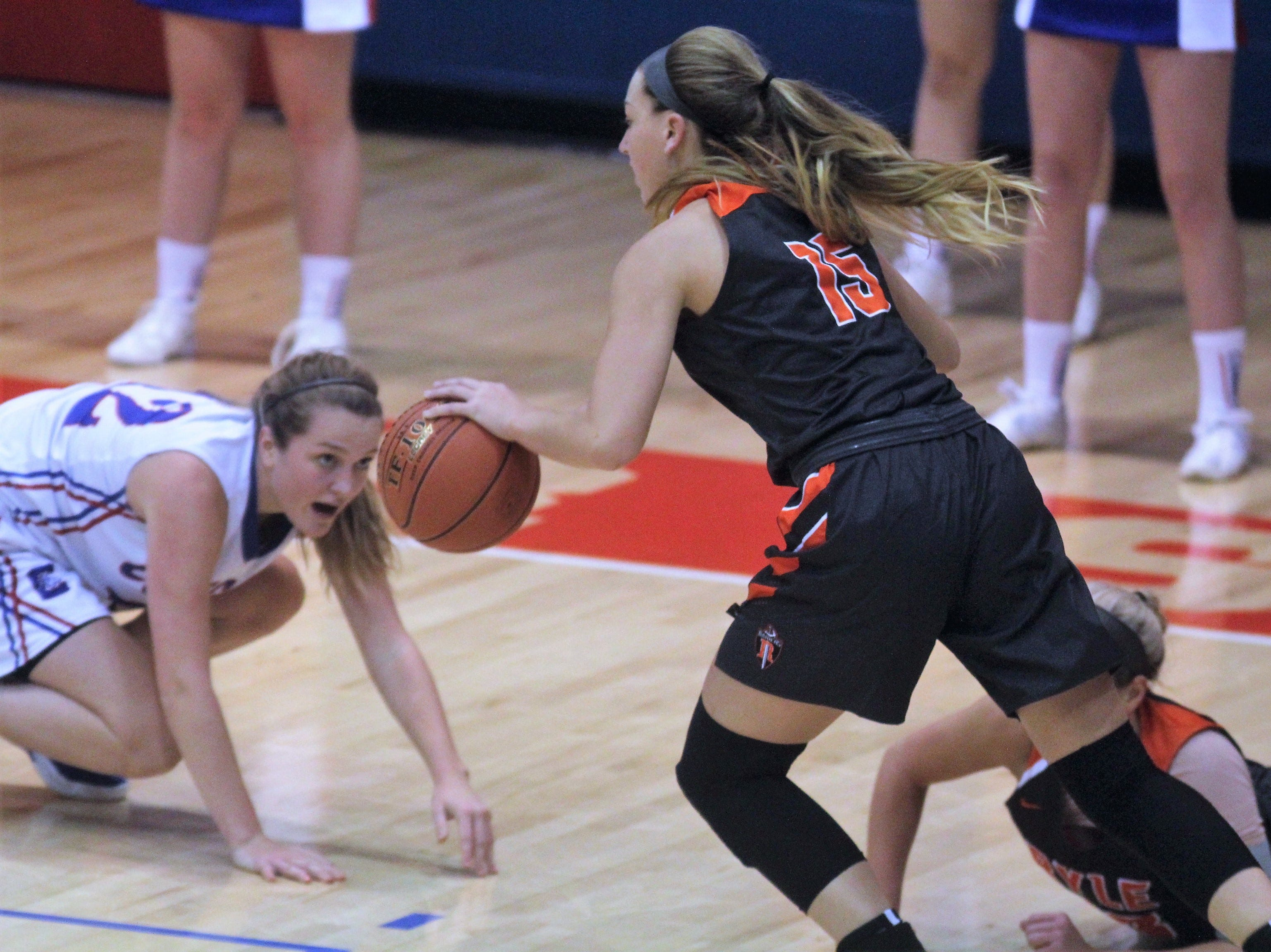 Ryle senior Lauren Schwartz grabs the loose ball as Conner senior Courtney Hurst gets up to defend as Ryle defeated Conner 60-49 in a girls basketball district game Dec. 7, 2018 at Conner High School, Hebron KY.