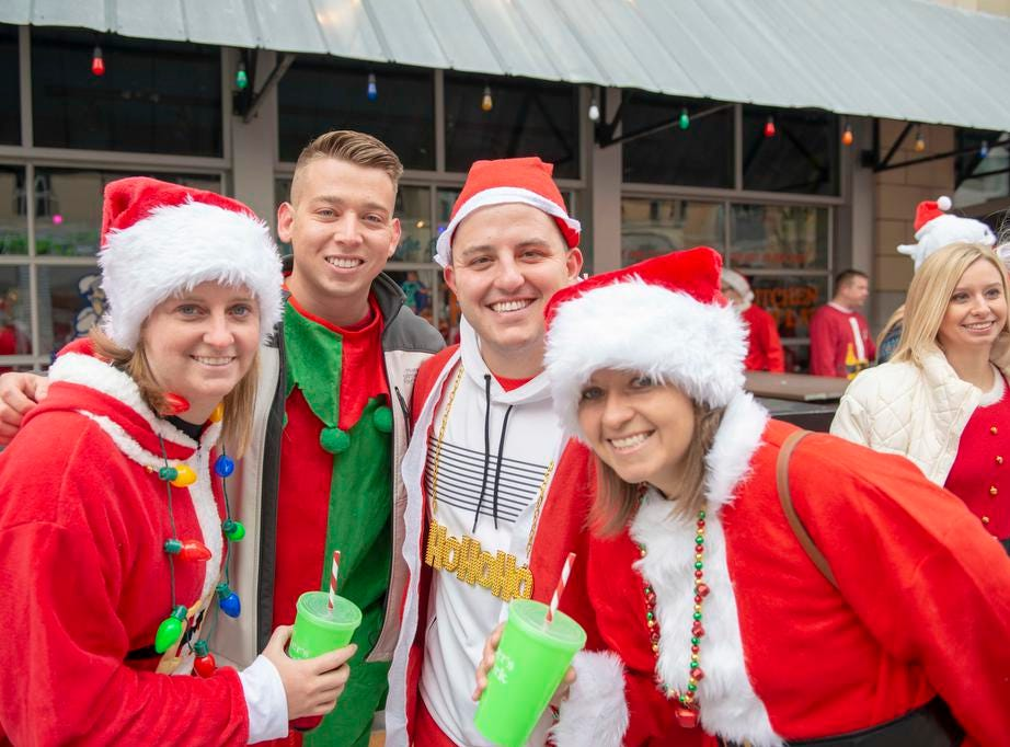 Cincinnati SantaCon 2018 brought hundreds of people dressed as Santa Claus and other Christmas characters to The Banks to spread good cheer and charity. Lindsay, Logan, Jacob and Ashleigh.