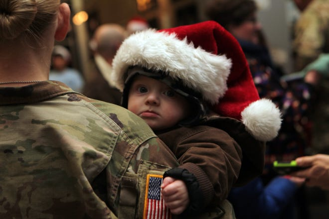 Easton Cox wears a Santa hat as he prepares to meet Santa at the annual Fort Campbell Christmas Tree Lighting on Friday, December 7, 2018, in Fort Campbell, Ky.