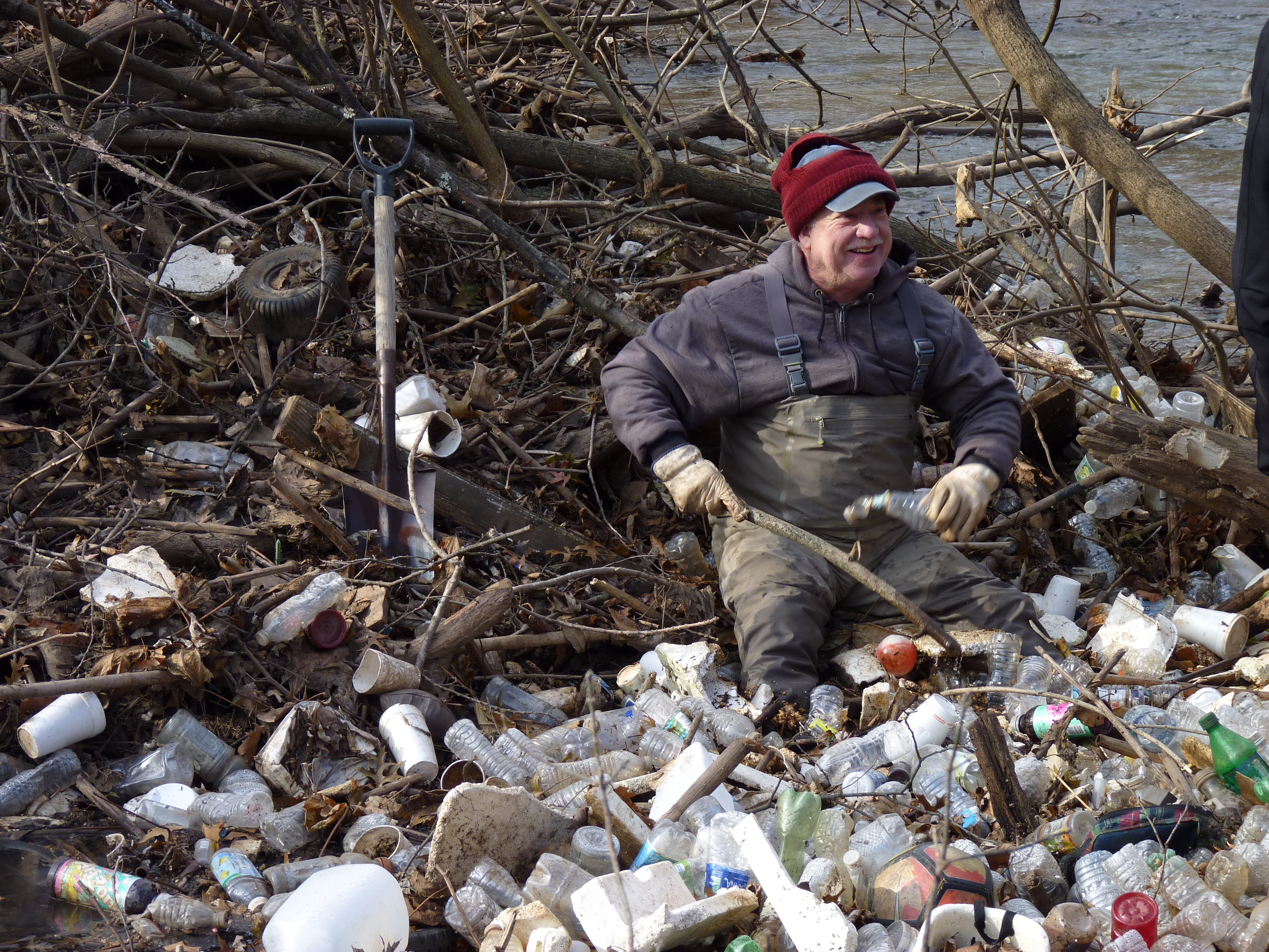 Andrew Still, of Middlesex, cleaning up the Green Brook on Dec. 8, 2018.