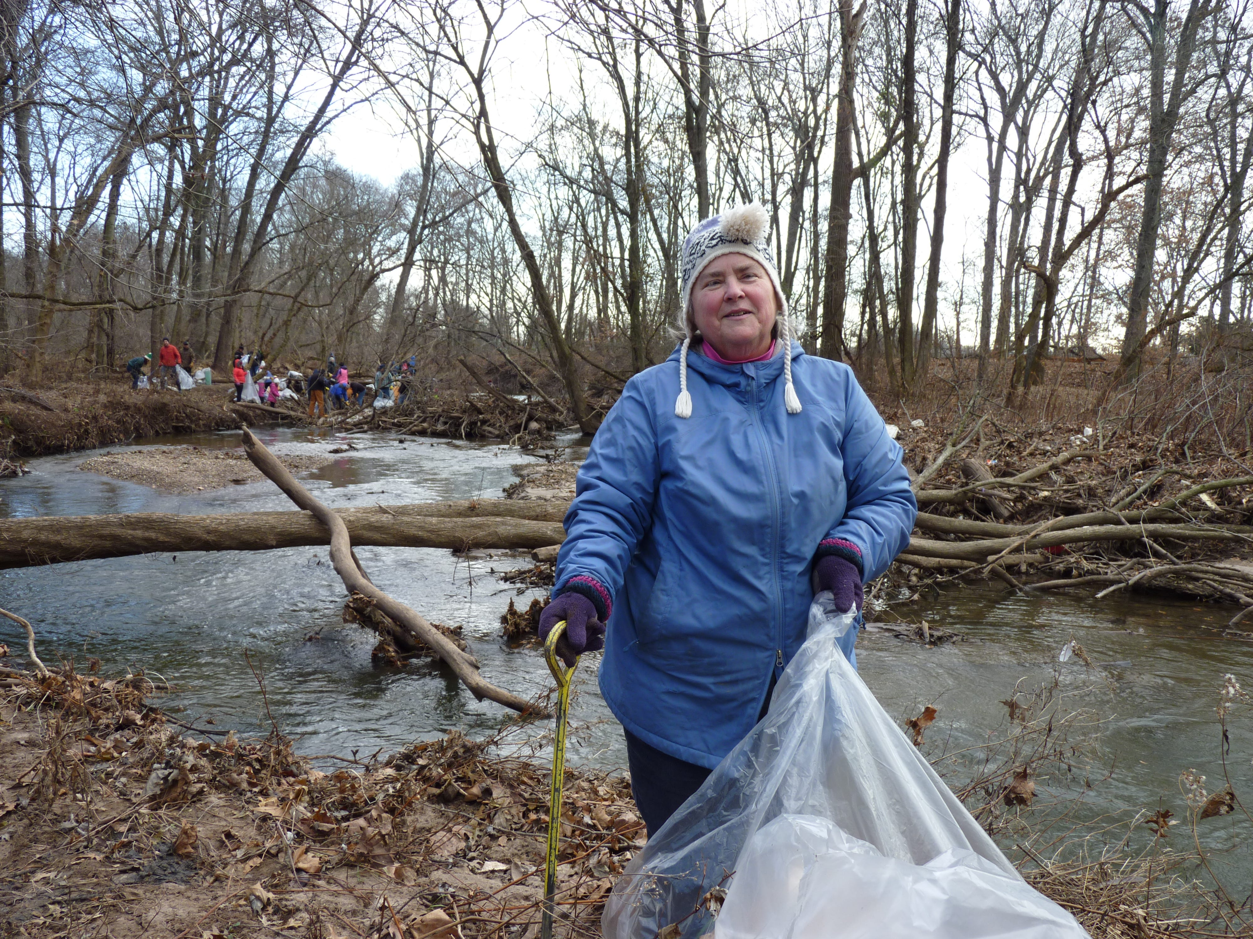 Cathy, a volunteer, helped clean up pollution in the Green Brook on Dec. 8, 2018.