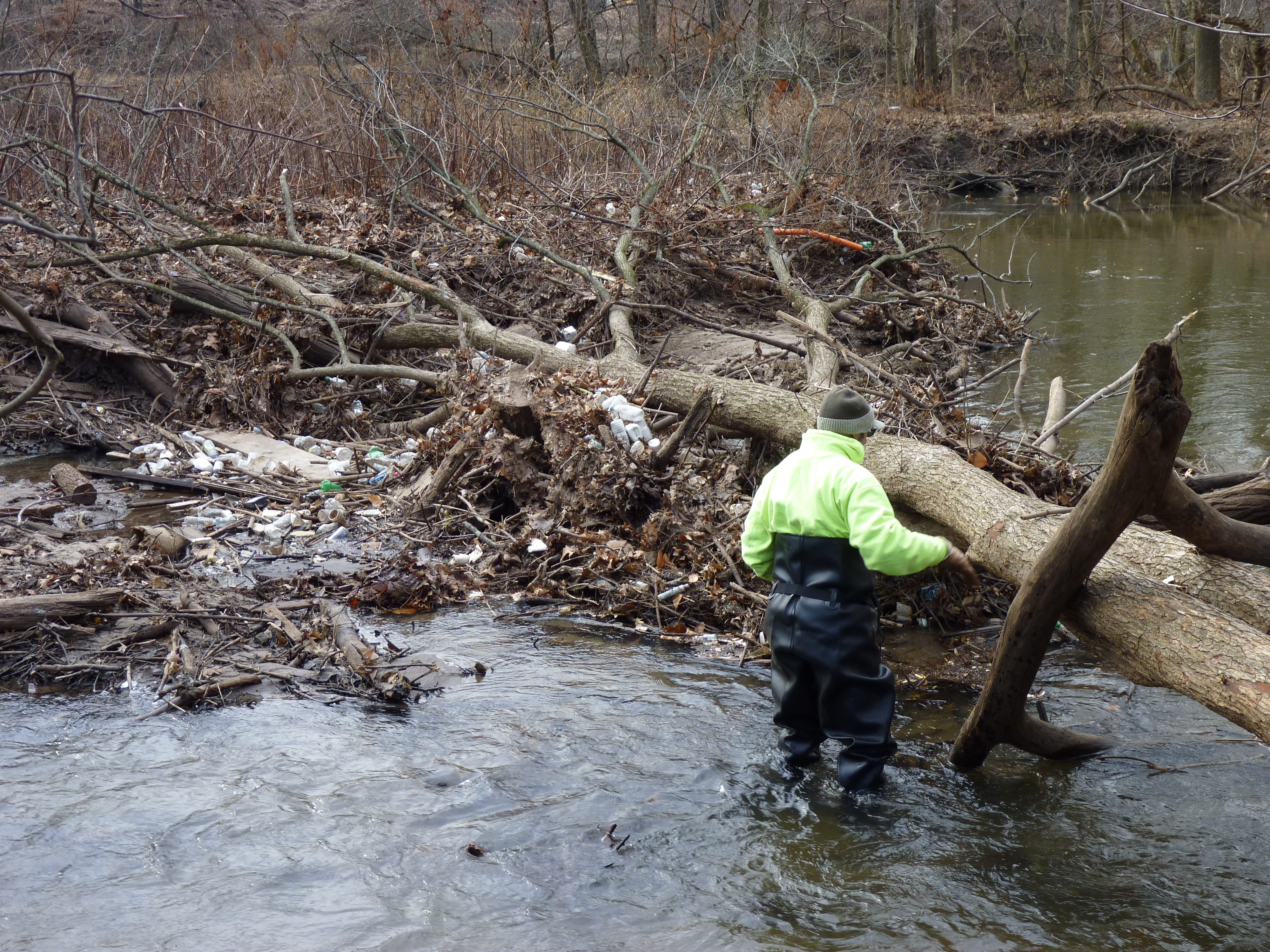 Volunteers braved the weather to clean up pollution in the Green Brook on Dec. 8, 2018.