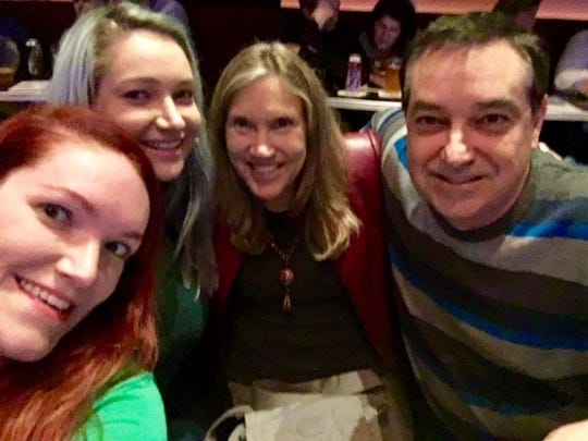 Iowa Columnist Courtney Crowder (far left) with her family: Audrey (her sister), Linda (her mother) and Tom (her father) at a Second City Show in Chicago, Illinois, in December 2017.
