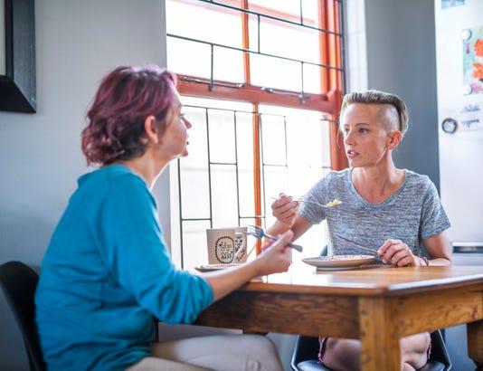 women Talking While Having Breakfast