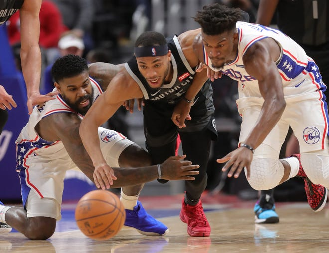 Pistons guard Bruce Brown goes for the loose ball against 76ers center Amir Johnson, left, and forward Jimmy Butler during the second quarter Friday, Dec. 7, 2018, at Little Caesars Arena.